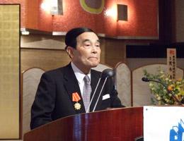 記念祝賀会で主催者あいさつの金川FEC会長
